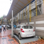 Two Level Dependent Car Parking Systems
